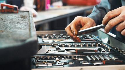 Set of tools for repair in car service, close up