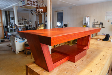 Workshop cabinetmaker. Redwood table. In the masterful joiner of the cabinetmaker. Work in process