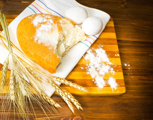 Freshly baked bread on wooden table