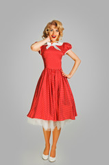 coquettish retro girl in spotted dress