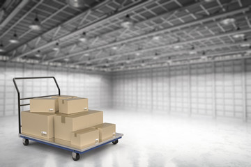 warehouse trolley with heap of storage boxes