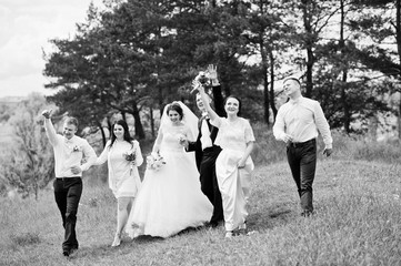 Funny and happy wedding couple with bridesmaids and best mans. B