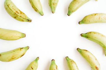 Round frame made of bananas. Flat lay, top view. Creative food concept