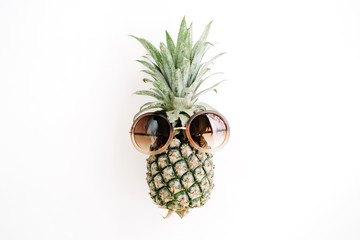 Hipster pineapple in sunglasses. Flat lay, top view