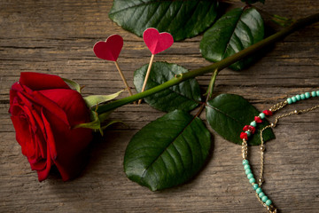 Red rose, hearts and  bracelet bijouterie
