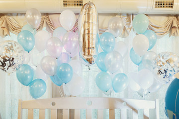 Blue balloons hang under ceiling