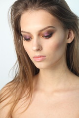 Closeup studio portrait of young beautiful model with professional makeup. Beautiful face of young adult woman