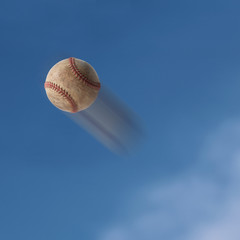 Old baseball flying into the sky.