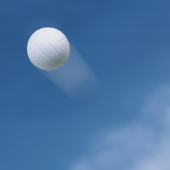 Volleyball flying into the sky.