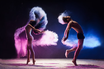 Nice couple poses in color dust cloud studio shot