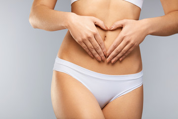 Health. Сloseup Beautiful Body With Heart Shaped Hands On Belly