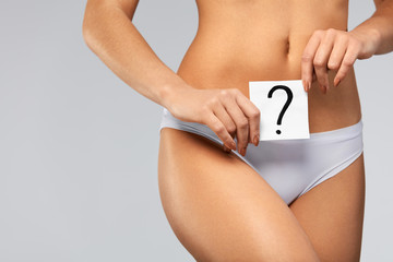 Health. Woman Body In Underwear With Question Card Near Belly