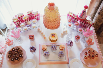 Look from above at candy shop with sweets made in pink, violet a