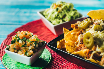 Tasty nachos with cheese and salsa