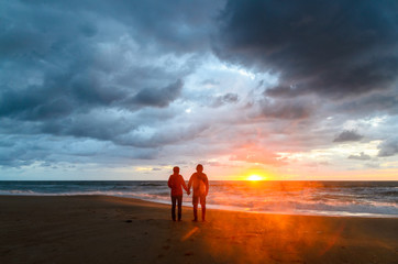 A couple during the sunset at the beach