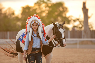 Beautiful womam sensuality elegance woman cowgirl on during sunset, Portrait nature. People and animals. Equestrian. vintage style