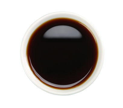 Soy sauce in white bowl isolated on background