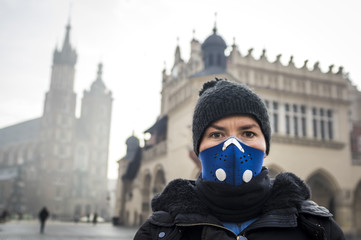 Woman using a mask, protecting herself from smog