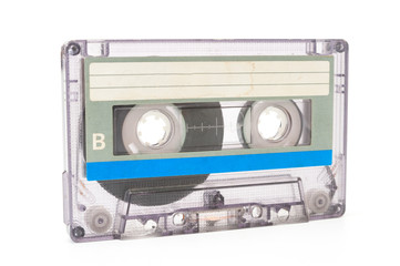 Used dust audio cassette on white background