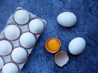 composition of fresh farm white eggs on dark background