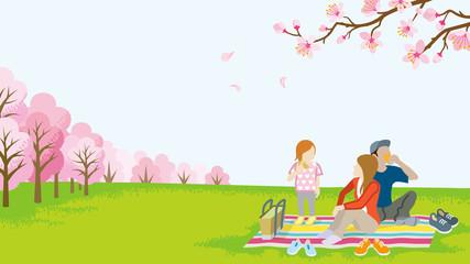 Family picnic in spring nature