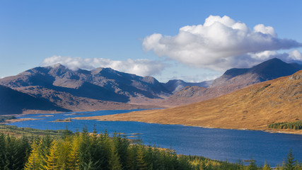 The road to the Scottish Highlands passing Loch Loyne and the distant mountains, Scotland, United Kingdom, Europe