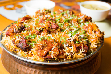 Hyderabadi biryani is a form of biryani, from Hyderabad, India.It is prepared in the form of kachay gosht ki biryani and dum ki biryani. Fototapete