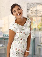 Attractive young lady smiling at vintage home
