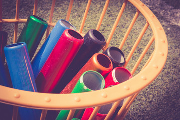 Many colorful school baton of running preparing in a basket for running competition. Running sport equipment concept.