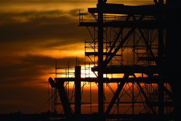 silhouette  construction site and sunset background.