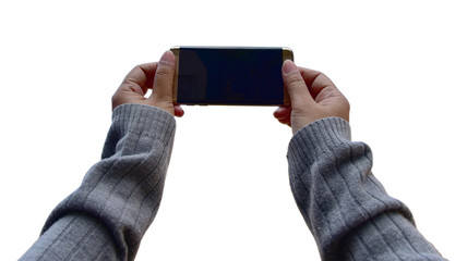 Isolate : Hands hold smartphone with gray sweaters, long sleeve take a picture.