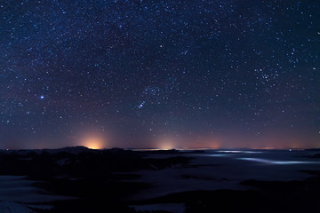 Night landscape with  mountains, sky,  stars