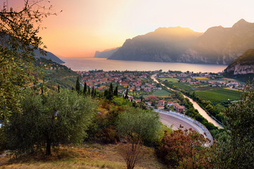 Scenic aerial view of Riva del Garda town, located on a shore of Garda lake, surronded by beautiful rocky mountains Wall mural