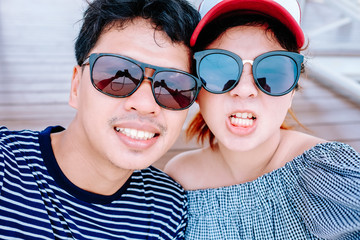 asian couple taking a selfie on vacation