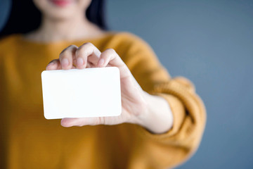 Woman holding blank business card. White Paper Card for Mockup