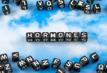 The word face Hormones on the sky background