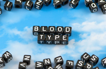 The word Blood type on the sky background