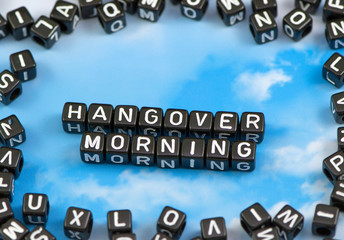 The word hangover morning on the sky background
