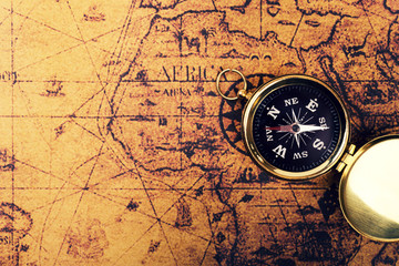 compass on old vintage world map with copy space