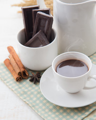 Foto op Plexiglas Chocolade Hot Chocolate in white cups with Chocolate bar on the wooden table
