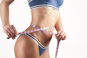 Woman measuring waistline, fitness and diet concept