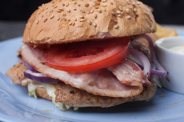 Burger with ham and tomato
