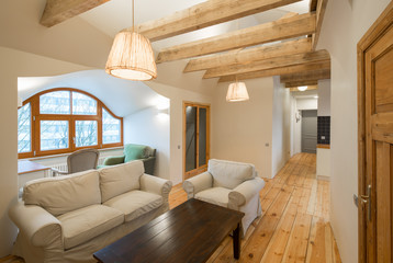 Wooden design. Apartment with wooden floors, ceilings and furnit