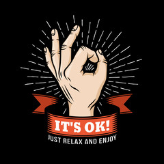 Logo OK  hand gesture with ribbon and sunburst on a black background. Vector illustration.