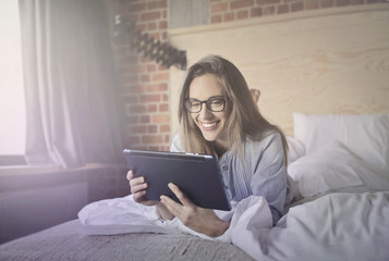 Woman happy with tablet