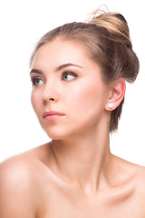 Beautiful Young Woman isolated on a White Background. Touching Her Face. Fresh Clean Skin.