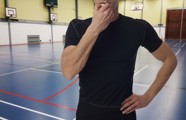 Basketball, handball trainer with workout plan close up on basketball field. Team sport, fitness and healthy life style concept.