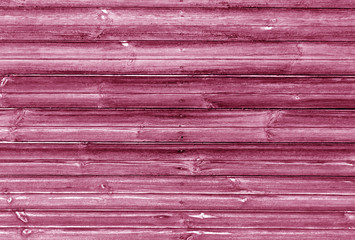 pink toned wooden wall texture.