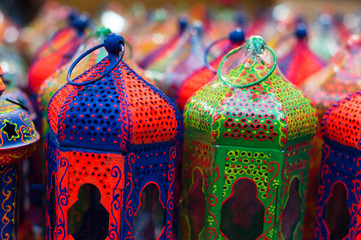 Lots of colorful handicraft metal lanterns painted in beautiful colors. This is a traditional art form of india and have been used to house religious lamps