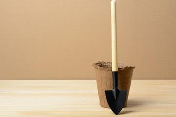 Peat pot and shovel